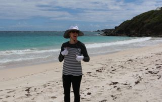 Dr Rostan enjoying an afternoon on the beach with excellent sun protection!