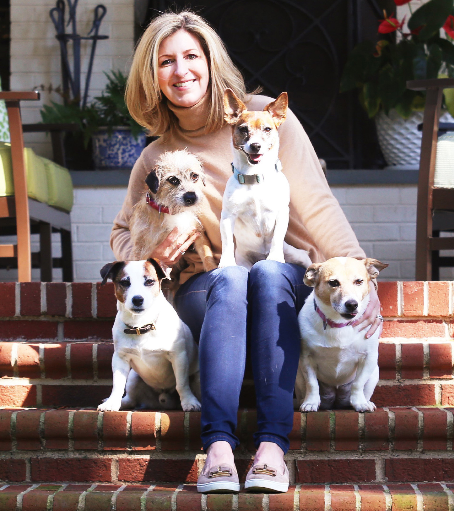 Dr. Rostan with her dogs on front porch